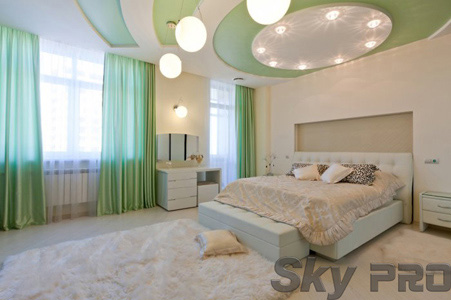 Двухуровневые сатиновые потолки в спальне